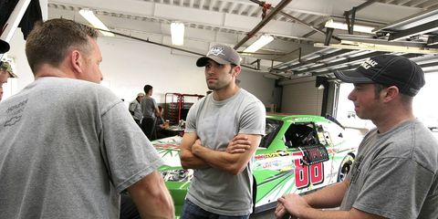 Aric Almirola hangs out in the garage last year. On Wednesday, Richard Petty Motorsports announced that Almirola would drive the team's No. 43 car in the 2012 NASCAR Sprint Cup Series.