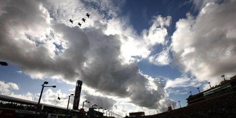 Four F-16 fighter jets fly over during the prerace festivities for the NASCAR Sprint Cup season finale at Homestead-Miami Speedway on Nov. 20. Photo by: Michael L. Levitt/LAT Photographic