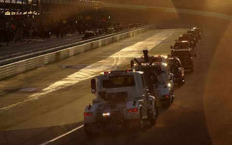 Safety trucks dry the track. Photo by: Michael L. Levitt/LAT Photographic