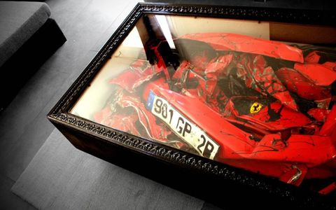Smashed Art // Just totaled your Ferrari? Give it to artist Charly Molinelli and he'll turn it into unique Ferrari coffee table. Photo by: Whitehotpix/ZUMAPRESS.com