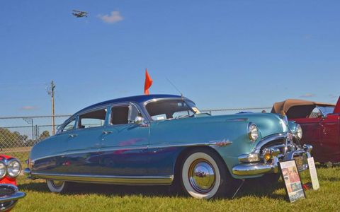 """The 1952 Hudson Hornet of Candy and Peter True. Young show goers are familiar with the model and brand through its featured prominence in the """"Cars"""" movie franchise."""