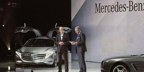 Mercedes-Benz boss Dieter Zetsche (left) introduces the second generation of the brand's mbrace system during his keynote speech at the 2012 Consumer Electronics Show.