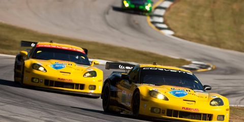One Corvette Team car chases another last year during an American Le Mans Series event in Georgia. The teams recently announced their new rosters.