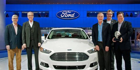 The redesigned 2013 Ford Fusion is the <i>Autoweek</i> Editor's Choice winner for Best in Show at the Detroit auto show. Those present at the trophy presentation were editor Wes Raynal, Ford design group vice president J Mays,  Ford design director Martin Smith, associate publisher and editorial director Dutch Mandel and Ford Americas Design executive director Moray Callum.
