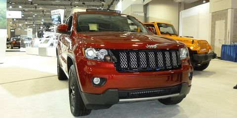 A version of Jeep's Grand Cherokee concept, painted a dark red, debuted at the Washington auto show on Thursday.
