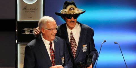 Richard Petty, right, presented first cousin Dale Inman at the third annual NASCAR Hall of Fame inductions ceremony in Charlotte, N.C. on Friday.