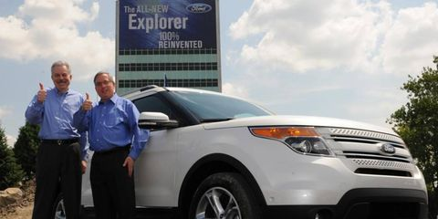 Ford executives Derrick Kuzak and Lewis Booth, shown at a launch event for the redesigned Ford Explorer in 2010, are retiring from the automaker.