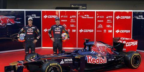 Drivers Daniel Ricciardo and Jean-Eric Vergne show off Toro Rosso's STR7 on Monday.