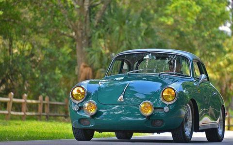 Tire, Wheel, Vehicle, Automotive lighting, Automotive mirror, Headlamp, Automotive design, Automotive parking light, Classic car, Car,