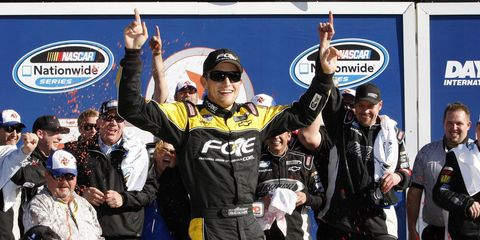 James Buescher celebrates in victory lane after winning the Nationwide race at Daytona on Saturday. Buescher avoided a crash on the final turn to coast to a win.