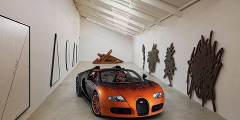 The Bugatti Grand Sport by Bernar Venet uses engineering equations as the paint fades from orange to black.