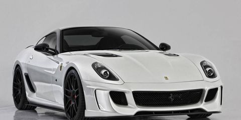 The aero kit includes a front bumper with an integrated carbon-fiber chin spoiler, a louvered racing hood with carbon-fiber vents and side sill extensions.