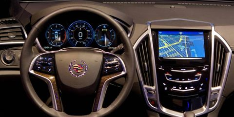 The Cadillac User Experience (CUE) infotainment system launches with the arrival of the XTS sedan in June.