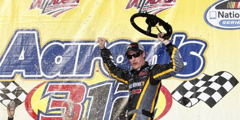 Joey Logano celebrates after winning the Nationwide race at Talladega Superspeedway on Saturday.