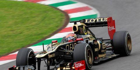 Romain Grosjean of Lotus topped Red Bull Racing's Sebastian Vettel's top morning time for the best time of Thursday's Formula One test at Mugello.