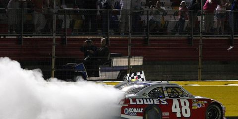 Jimmie Johnson celebrates his Sprint All-Star Race win with a long burnout. Johnson led for the final 10 laps, winning $1 million in process.
