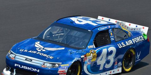 Aric Almirola scored his first career Sprint Cup pole on Thursday at Charlotte Motor Speedway.