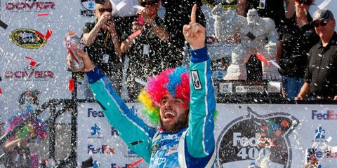 Jimmie Johnson won his second Sprint Cup Series points race of the season and Hendrick Motorsports made it four wins in a row on Sunday in Dover, Del.