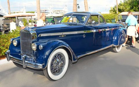 The 1930 Stutz two-door coupe of William T. Gacioch awaits its turn in the spotlights of Ocean Reef's Vintage Weekend. The long trunk was custom built to accommodate the luggage belonging to the wife of the original owner.