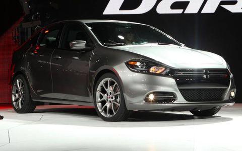 Tire, Wheel, Motor vehicle, Automotive design, Vehicle, Land vehicle, Automotive lighting, Event, Automotive mirror, Car,