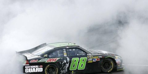 Dale Earnhardt Jr. burns out after winning in Michigan on Sunday. It was the popular driver's first win in four seasons.