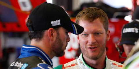 Jimmie Johnson, left, talks with Dale Earnhardt Jr. before racing to the pole at Kentucky Speedway on Friday night.