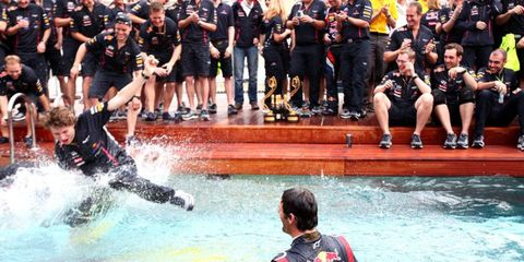 Monte Carlo, Monaco 27th May 2012 Mark Webber, Red Bull Racing, and the Red Bull team celebrate in the Energy Stations swimming pool.