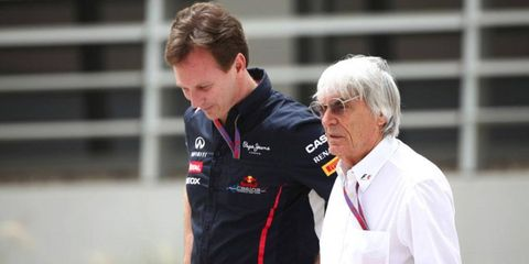 Bernie Ecclestone, right, shown here with Red Bull principal Christian Horner, has reportedly been under investigation since 2011.