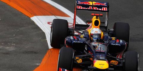 Two-time defending world champion Sebastian Vettel had the best time through two of three practice sessions in Spain.