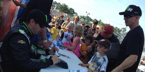Kyle Busch signs autographs for hundreds of fans after he won an ARCA race on Tuesday in west Michigan.