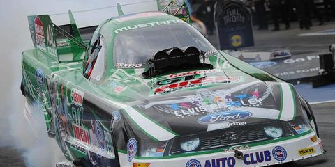 John Force led the Funny Cars in qualifying at Joliet, Ill., on Friday night.