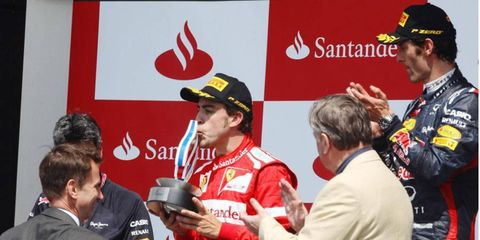 Fernando Alonso kisses the runner-up trophy at Silverstone on Sunday. He hopes to get a bigger prize at season's end.