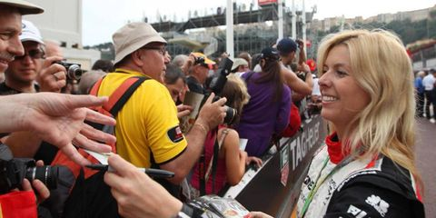 Maria De Villota signs autographs for fans back in May of this year. On Tuesday she was involved in an accident and is still being hospitalized.