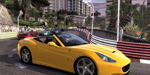 Here's a screenshot of a pack of Ferrari's speeding around the famed Monaco street circuit.