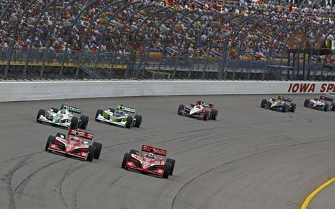 Dario Franchitti and Scott Dixon contest the lead ahead of Tony Kanaan, Ryan Hunter-Reay and Helio Castroneves on June 20, in Newton, Iowa.