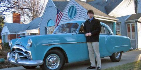 The author and his 1951 Packard 200 in March 2006. The car's looks have held up better than the author's hairstyle.