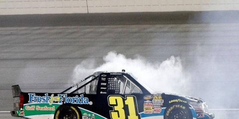 James Buescher celebrates his NASCAR Camping World Truck Series win at Chicagoland on Saturday night.