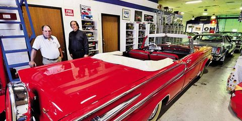 The 1958 convertible Park Lane dwarfs other cars in Herk's garage. He's seen here with collaborator Ottino (left). Herk's two-door black Park Lane had only one owner before he found it in Kentucky in 2006.