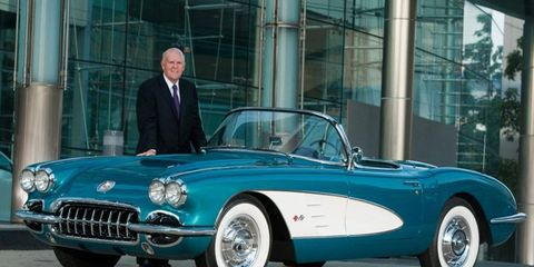 GM CEO Dan Akerson stands with his 1958 Chevrolet Corvette that will be sold to raise funds for charity.