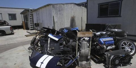 Parts strewn about in a police impound yard after being recovered from the chop-shop.