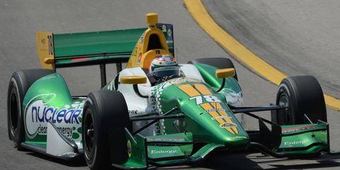 Simona de Silvestro drives her Lotus earlier this season. Lotus has said that it plans to make dramatic cutbacks to its motorsports programs in 2013.