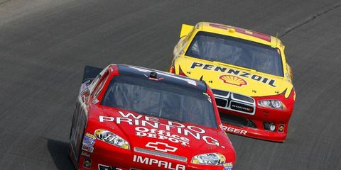 Tony Stewart leads Sam Hornish Jr. in Chicago. The 2013 Sprint Cup schedule is set to be officially released later this week.