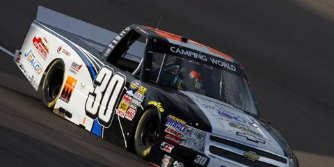 Nelson Piquet Jr. made a pass on the last lap to steal a truck win from Matt Crafton in Las Vegas on Saturday night.