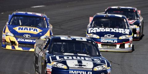 Jimmie Johnson (above) has had quite a bit of success at Dover, the site of this week's Chase race. Denny Hamlin, on the other hand, has struggled.