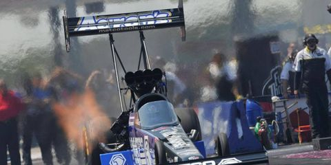 Antron Brown's win at Dallas on Sunday moved him into a tie for the top spot in the Top Fuel points.