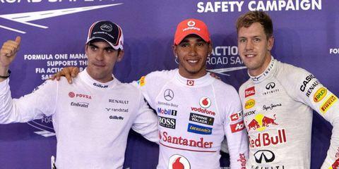 Pastor Maldonado, pole winner Lewis Hamilton and Sebastian Vettel will start in the first three spots on the grid at Singapore on Sunday.