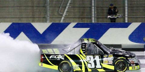 James Buescher does his burnout after sweeping both races at Kentucky Speedway in 2012.