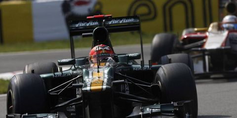 Heikki Kovalainen drives the Caterham CT01 Renault in the Italian Grand Prix. Recently, Caterham hired Cyril Abiteboul to be the CEO of their Formula One team.