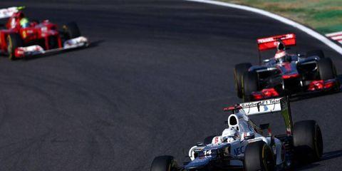 Kamui Kobayashi leads this pack into a turn at Suzuka on Sunday.