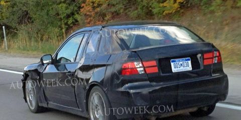 Is this the new 2014 Subaru WRX coupe? Subie officials say no, but this two-door mule was caught testing recently near the company's Ann Arbor, Mich.,-based research facility.